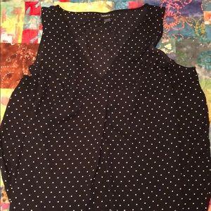 Black sleeveless blouse with white polka dots